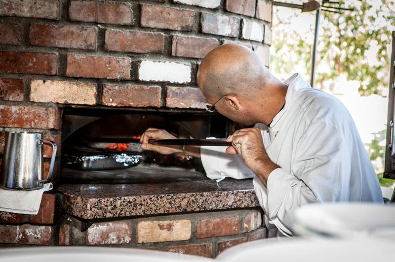 Gourmet Pizzas in a Wood-burning oven at Trattoria Pina Italian Restaurant